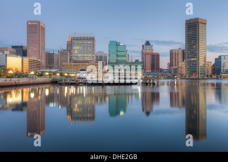 Baltimore skyline at dawn, including the Transamerica Tower and World Trade Center, reflected in the waters of the - Stock Photo