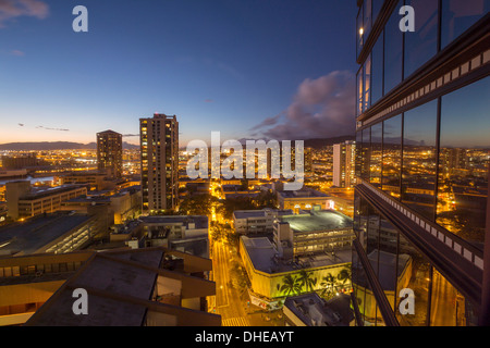 Overview of Chinatown at night in downtown Honolulu - Stock Photo