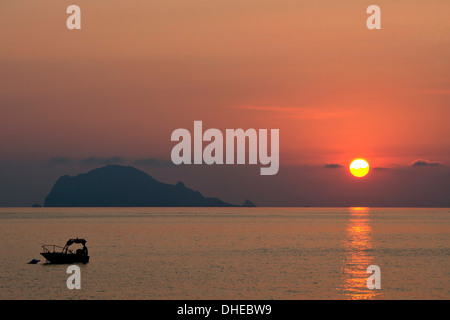A view to Filicudi Island from Salina Island at sunrise in The Aeolian Islands, UNESCO, off Sicily, Messina Province, - Stock Photo