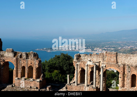 A view of the Greek Theatre and Naxos Bay on the Ionian Sea from Taormina, Sicily, Italy, Mediterranean, Europe - Stock Photo