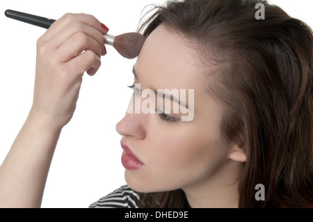 young woman applying blusher - Stock Photo