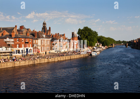 People sitting along Kings Staith by the River Ouse on a summer evening, City of York, Yorkshire, England, United - Stock Photo
