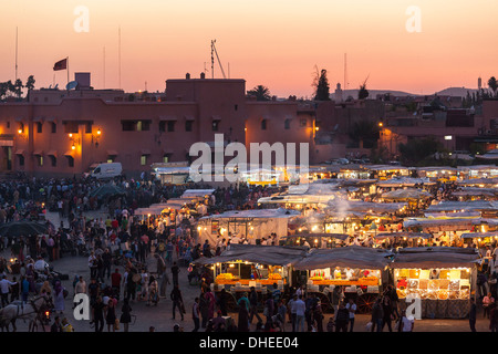 Food stalls in the Jemaa El Fna at sunset, Marrakesh, Morocco, North Africa, Africa - Stock Photo
