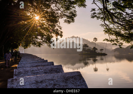 Sunrise at Kandy Lake and the island which houses the Royal Summer House, Kandy, UNESCO, Central Province, Sri Lanka - Stock Photo