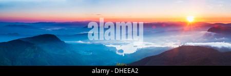 Adams Peak (Sri Pada) view at sunrise, mountains and the Maussakele Reservoir, Central Highlands, Sri Lanka, Asia - Stock Photo
