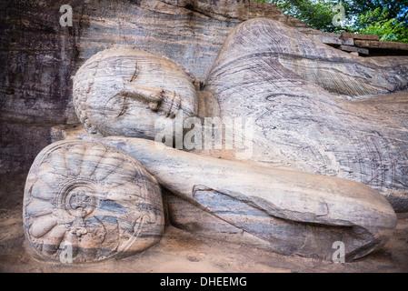 Reclining Buddha in Nirvana at Gal Vihara Rock Temple, Polonnaruwa, UNESCO World Heritage Site, Sri Lanka, Asia - Stock Photo