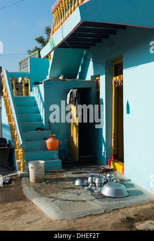 Indian cooking pots left in the sun to dry outside a rural indian village house. Andhra Pradesh, India - Stock Photo