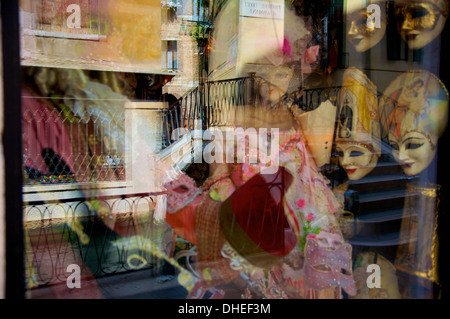 Reflection of Venetian masks, Venice, Veneto, Italy, Europe - Stock Photo