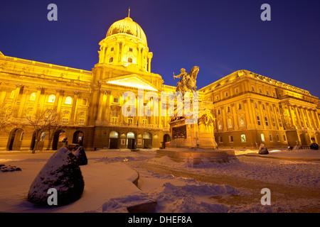 Royal Palace illuminated on a winters night, Castle Hill, Budapest, Hungary, Europe - Stock Photo