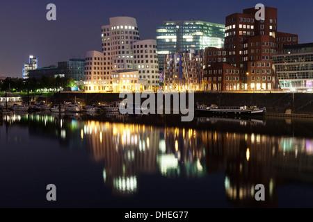 Neuer Zollhof, designed by Frank Gehry, Media Harbour (Medienhafen), Dusseldorf, North Rhine Westphalia, Germany, - Stock Photo