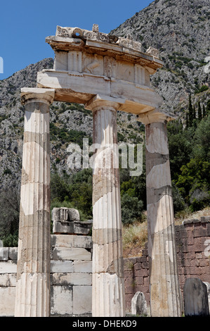 The tholos, a circular building at the centre of the sanctuary of Athena Pronaia, Delphi, UNESCO, Peloponnese, Greece - Stock Photo