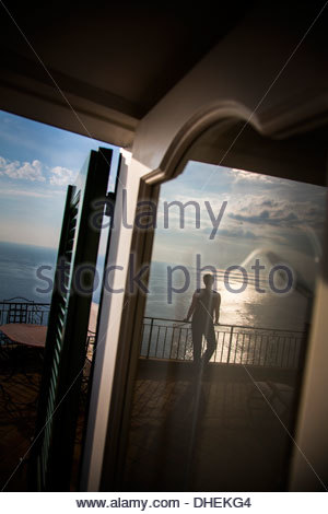 Woman standing on a terrace and looking Mediterranean Sea, Praiano, Campania, Italy - Stock Photo