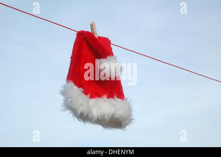 Illustration - A Santa Claus hat is pictured on a clothesline, 28 December 2009. Photo: Berliner Verlag/Steinach - Stock Photo