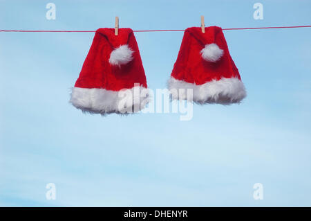 Illustration - Two Santa Claus hats are pictured on a clothesline, 28 December 2009. Photo: Berliner Verlag/Steinach - Stock Photo