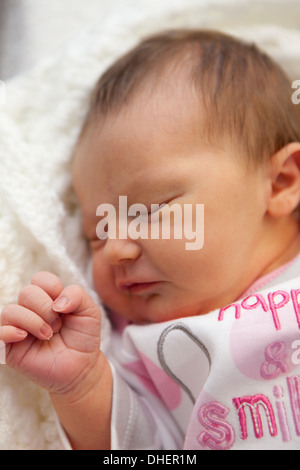 A newborn baby girl sleeps in her cot in the Luton and Dunstable hospital where she was born UK - Stock Photo