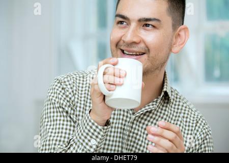 Mid adult man having coffee - Stock Photo