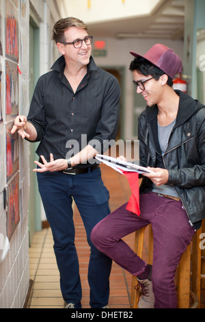 Fashion design teacher and student in discussion - Stock Photo