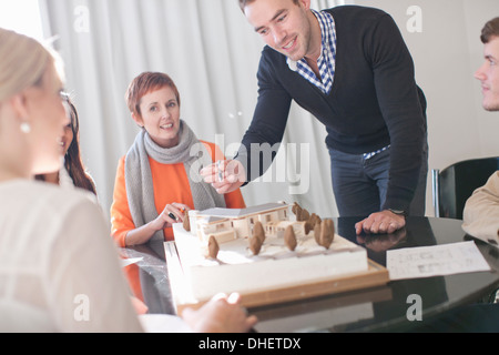 Meetings in architects office, looking at model - Stock Photo