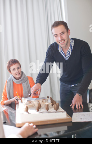 Architects and architectural model - Stock Photo