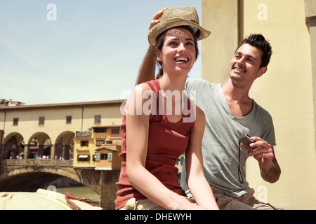 Man and woman by Ponte Vecchio, Florence, Tuscany, Italy