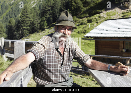 Farmer posing for camera - Stock Photo