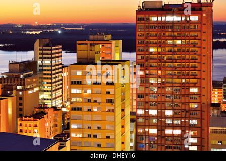 Brazil, Rio Grande do Sul: Nocturnal top view to Porto Alegres high rise towers and illuminated buildings - Stock Photo