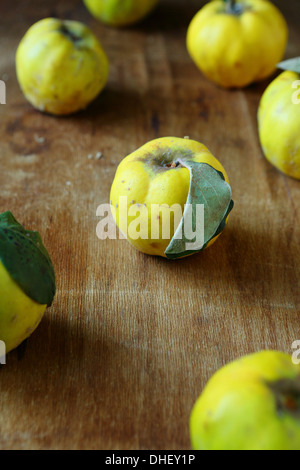 Natural quince on an old wooden table, food - Stock Photo