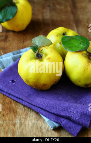 Natural ripe quince on the wooden table, food - Stock Photo