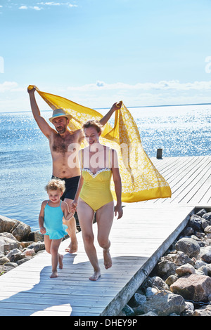 Parents and two daughters on pier, Utvalnas, Gavle, Sweden - Stock Photo