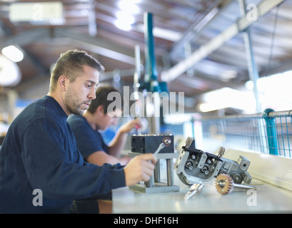 Engineer working on production line in factory - Stock Photo
