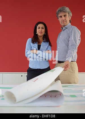 Two architects with blueprints - Stock Photo