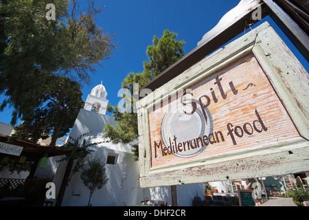 SANTORINI (THIRA), CYCLADES, GREECE. A rustic wooden taverna sign in the village of Meghalochori. 2013. - Stock Photo