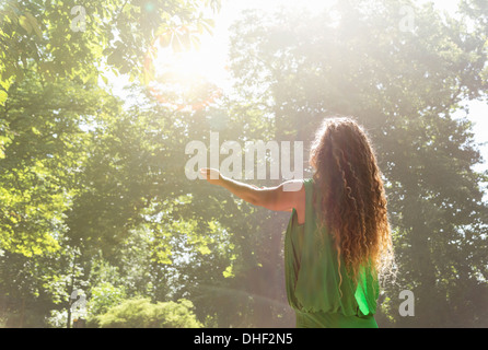 Teenage girl wearing green top with arms out, Prague, Czech Republic - Stock Photo