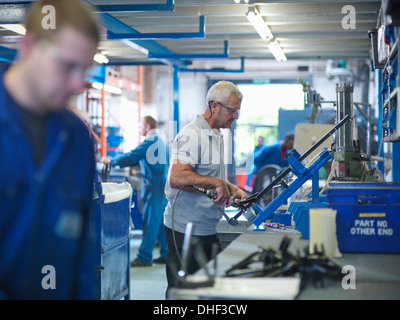 Workers on production line in factory - Stock Photo