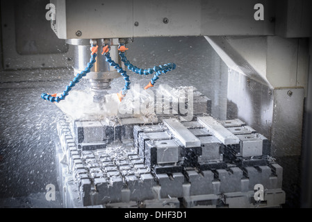 Lathe cutting components in factory - Stock Photo