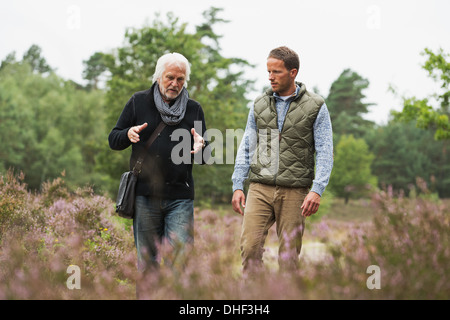 Father and adult son walking - Stock Photo