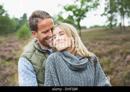 Mid adult couple hugging - Stock Photo