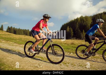 Young woman and man mountain biking, Styria, Austria - Stock Photo