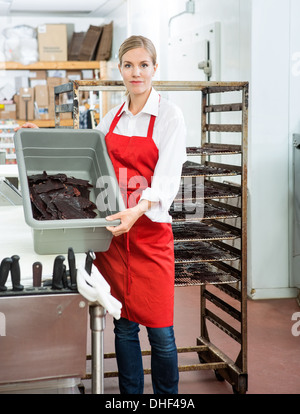 Worker Showing Beef Jerky In Basket At Butcher's Shop - Stock Photo