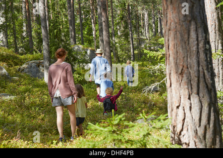 Family walking through forest - Stock Photo