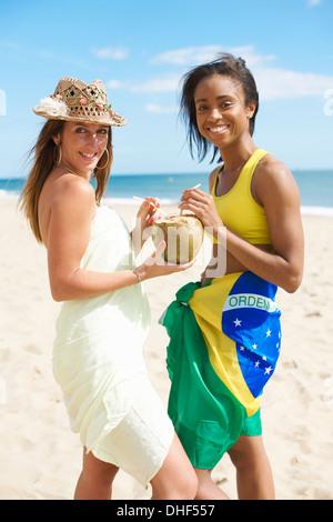 Women sharing coconut water - Stock Photo