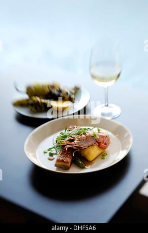 Still life with prawn, potato and micro greens - Stock Photo
