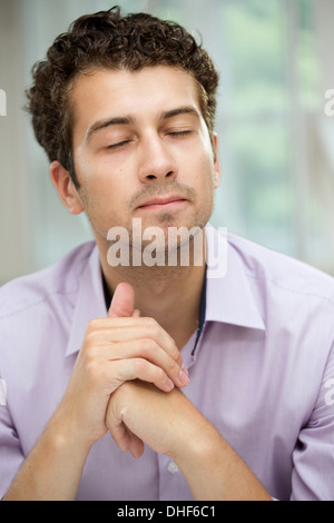 Young man in deep thoughts - Stock Photo