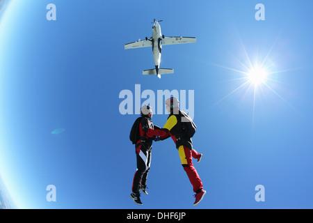 Female skydivers free falling above Leutkirch, Bavaria, Germany - Stock Photo