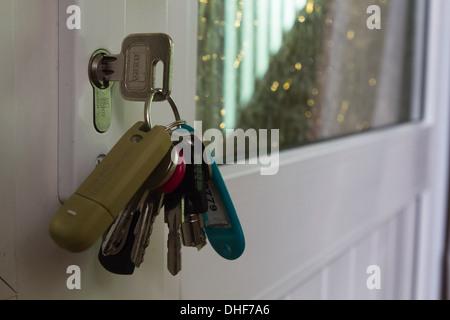 Keys in Door - Stock Photo
