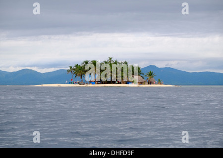 Distant view of small islands fringed with palm trees in the 'Comarca' (region) of the Guna Yala natives known as - Stock Photo