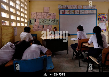 Schoolgirls having a lecture in a high school in Carti Sugtupu island village administered by Guna natives known - Stock Photo