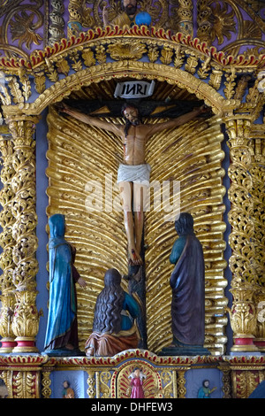 A wooden figure of the Crucifixion of Jesus Christ on the Cross inside Iglesia de San Antanacia church in The Villa de Los Santos town in Peninsula de Azuero Republic of Panama