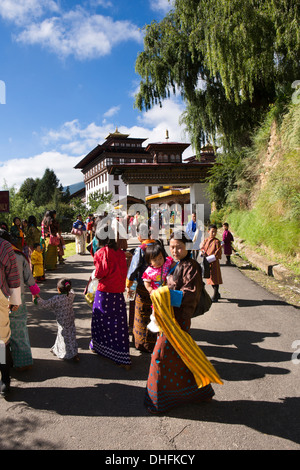 Bhutan, Thimpu Dzong, annual Tsechu, festival goers approaching Dzong festival ground - Stock Photo