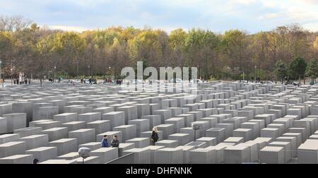 Berlin, Germany. 09th Nov, 2013. Visitors walk around the Holocaust memorial in Berlin, Germany, 09 November 2013. - Stock Photo